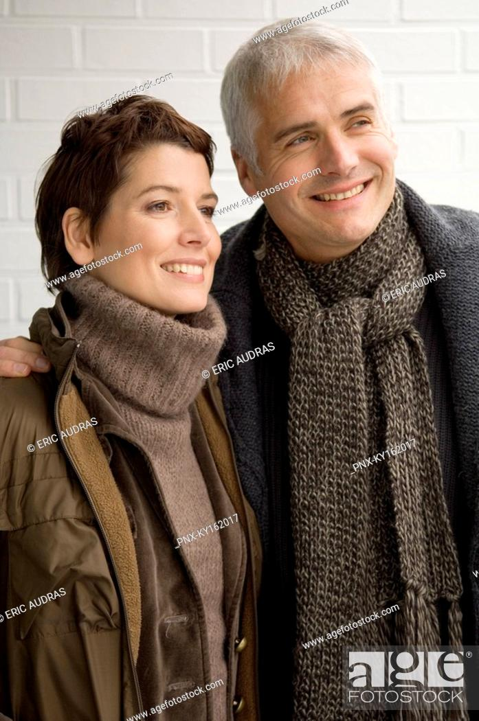 Stock Photo: Close-up of a mature man and a mid adult woman standing.