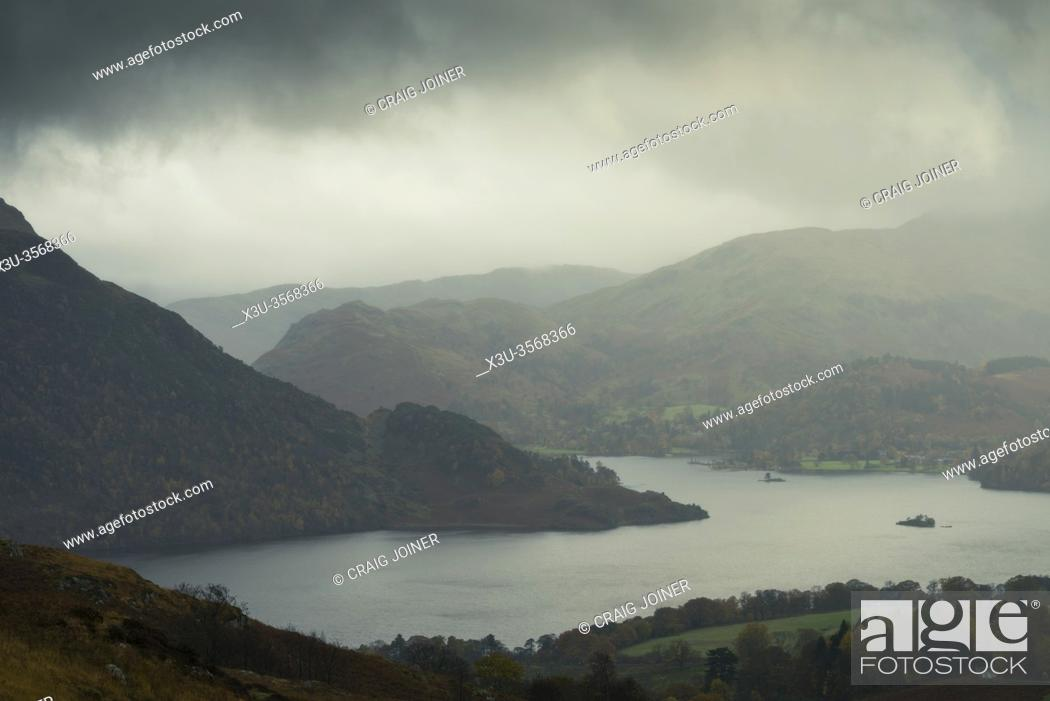 Stock Photo: Autumn rainstorm over Ullswater lake from Gowbarrow Fell in the Lake District National Park, Cumbria, England.