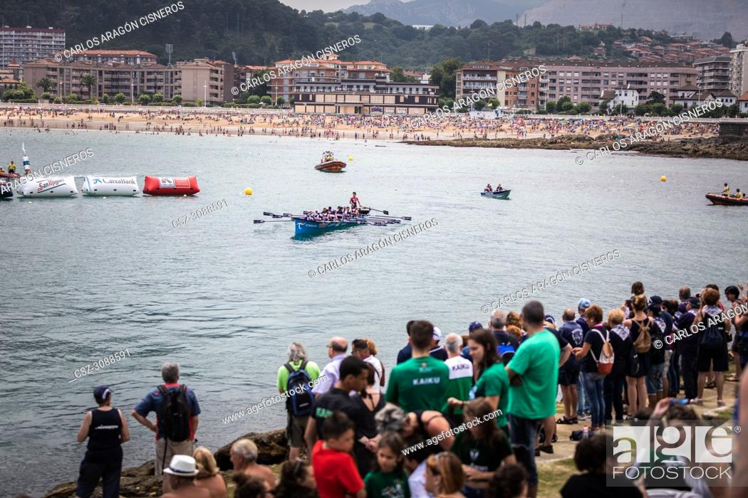 Stock Photo: CASTRO URDIALES, SPAIN - JULY 15, 2018: Competition of boats, regata of trainera, Urdaibai Avia boat greets the public after winning the competition VI Bandera.