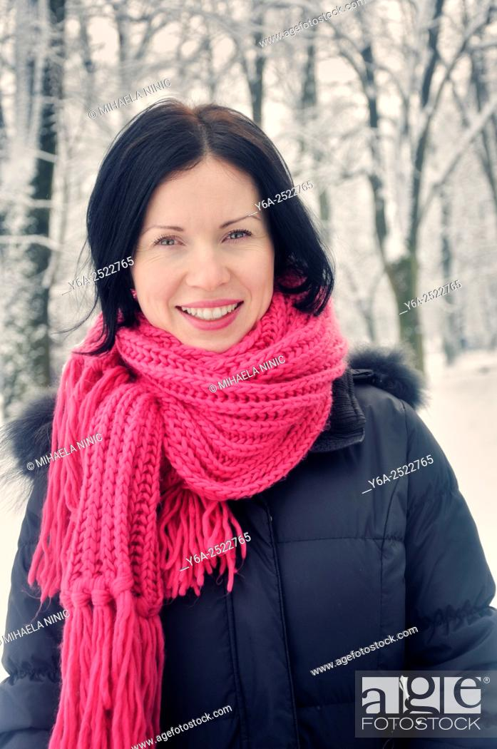 Stock Photo: Portrait of a smiling mid adult woman, winter.