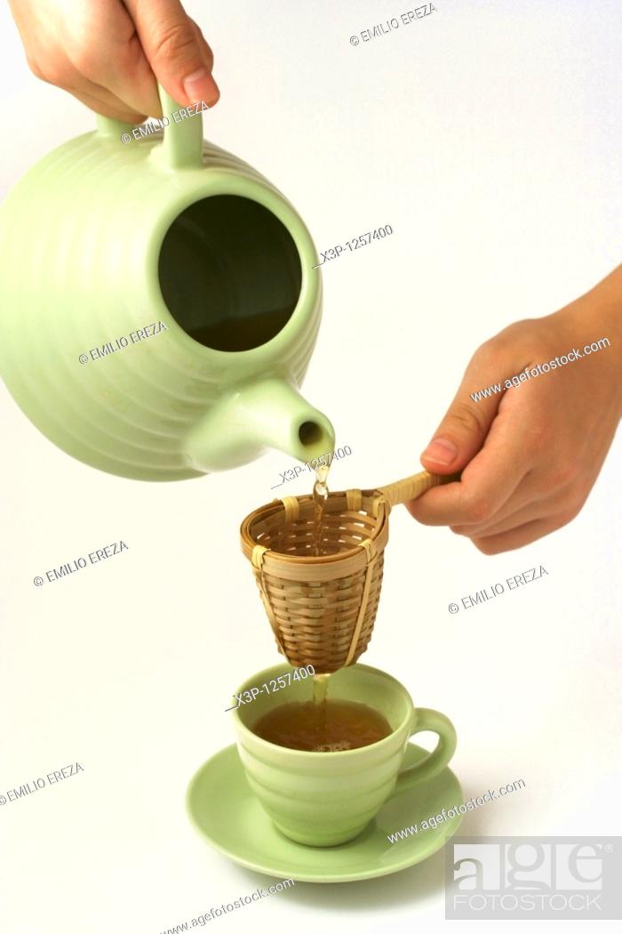Stock Photo: Pouring tea.