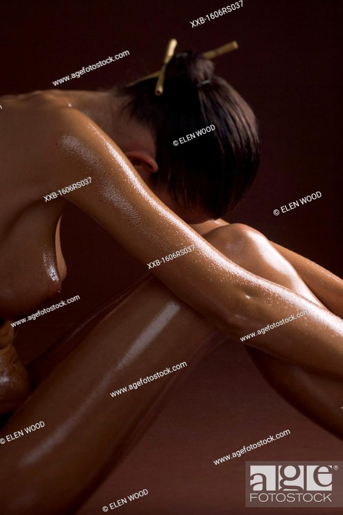 Stock Photo: woman cover in oil.