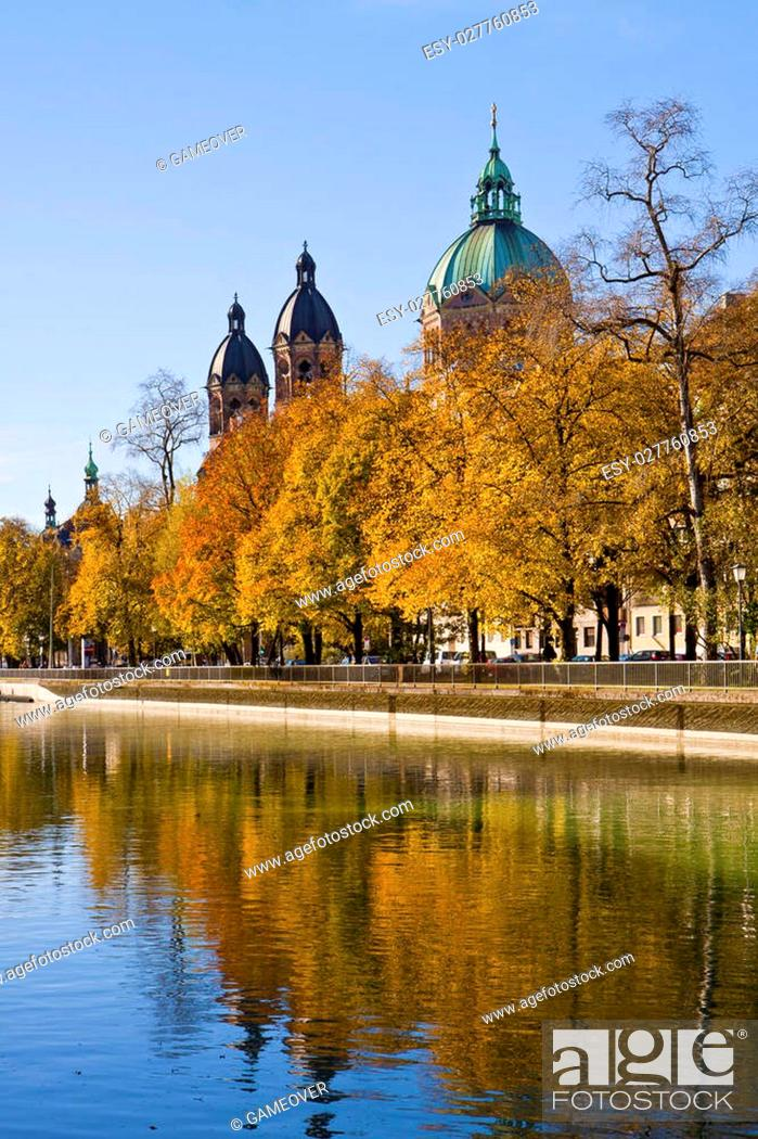 Stock Photo: View of St. Luke's church domes and the Isar banks on autumn.