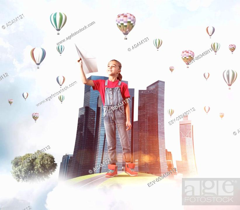 Stock Photo: Cute kid girl on city floating island throwing paper plane.