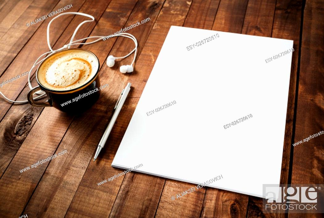 Stock Photo: Blank branding template on vintage wooden table background. Blank letterhead, coffee cup, headphones and pen. Photo of blank stationery.