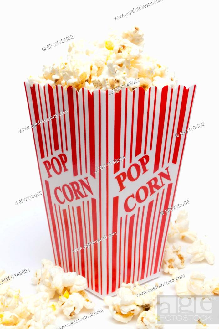 Stock Photo: Studio shot of a red striped carton of popcorn with Popcorn printed on it.