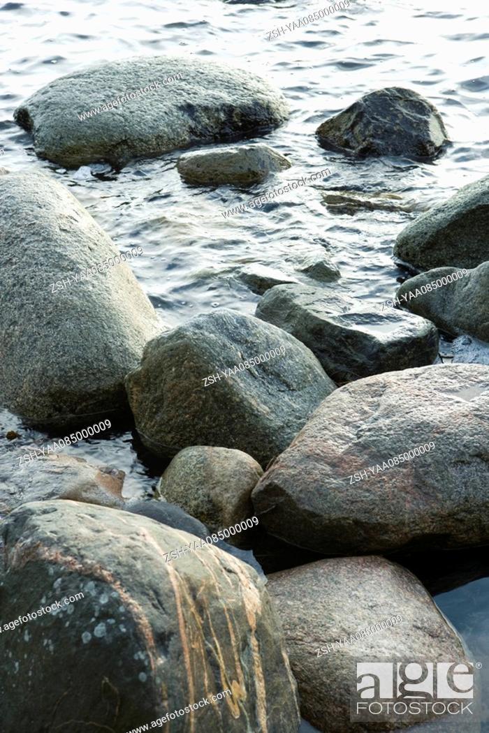 Stock Photo: Rocks in water.