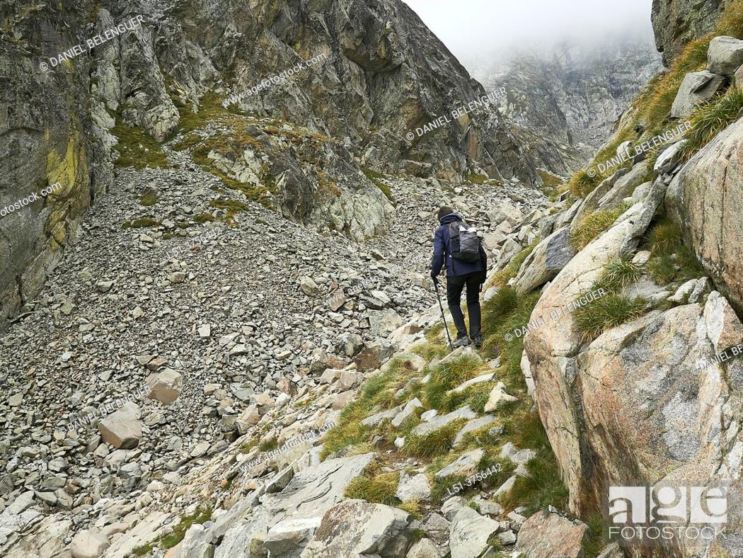 Stock Photo: Middle age woman hiking on Lliterola valley , Benasque, Aragón, Spain.