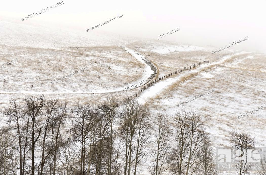 Stock Photo: Canada, BC, Bridesville. Farm roads running through cold, snowy fields.