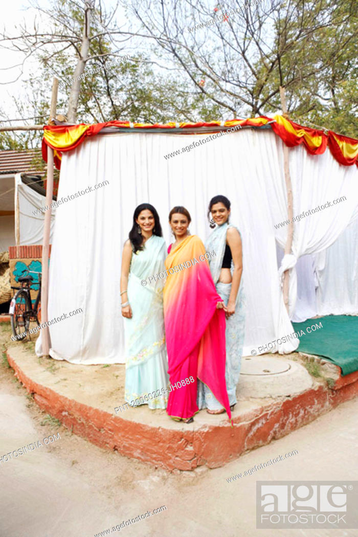 Stock Photo: Portrait of three young women standing in front of a tent.