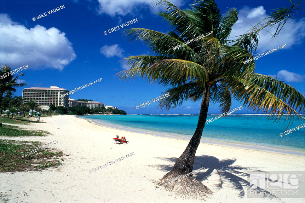 Stock Photo: Guam, Tumon Bay, Woman on Ypao Beach, Flores Park w/ Hilton Hotel in bkgd B1727.