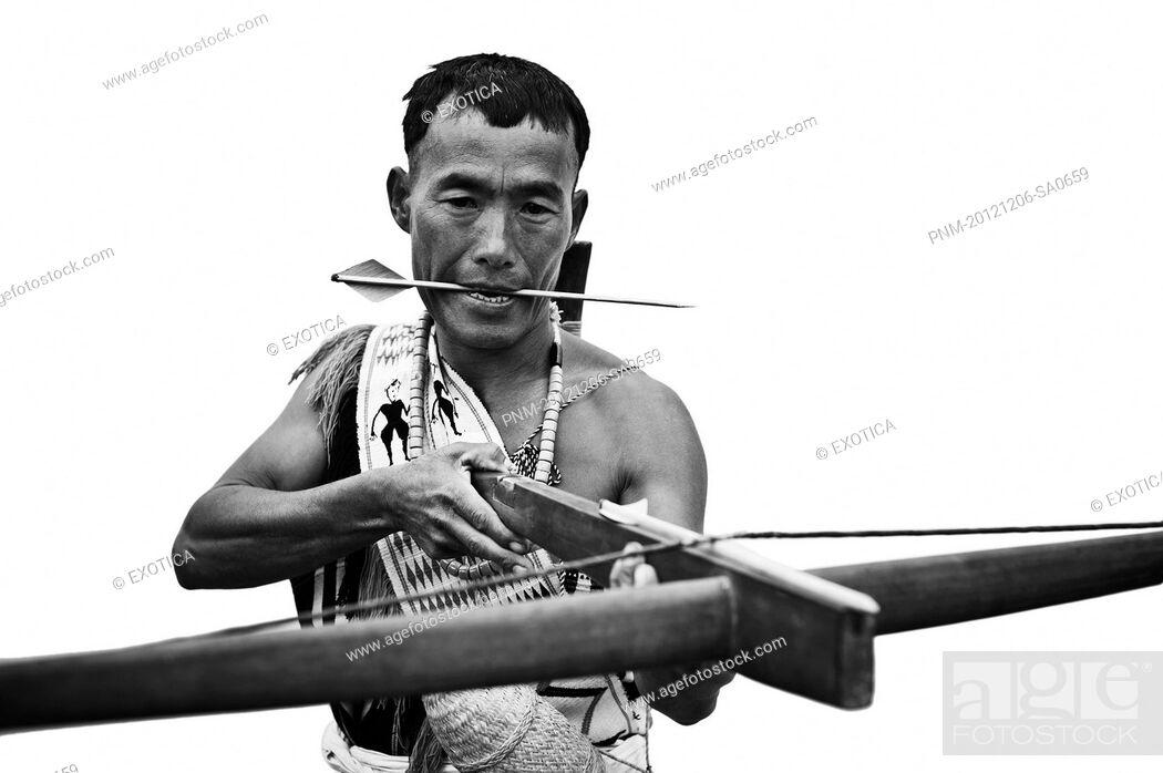Stock Photo: Naga tribal warrior holding a cross bow, Hornbill Festival, Kohima, Nagaland, India.