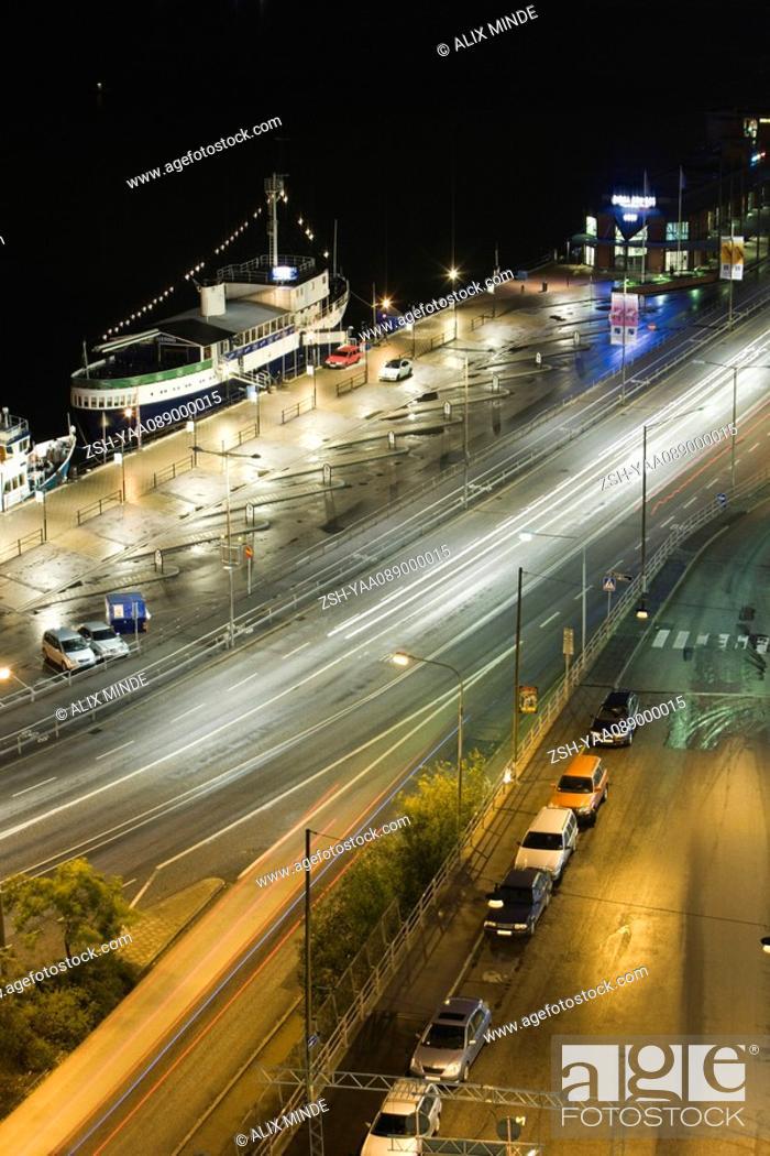 Stock Photo: Sweden, Stockholm, brightly illuminated street at night.