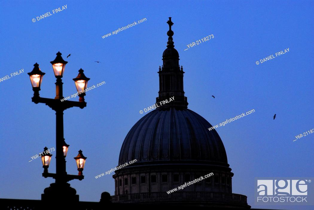 Stock Photo: St. Paul's Cathedral in London, England, seen late in the evening, with Southwark Bridge in the foreground.