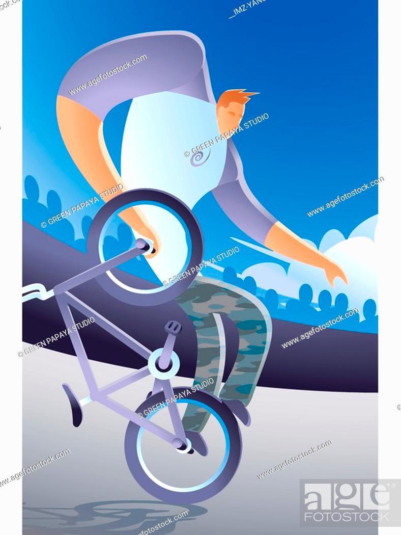 Stock Photo: A man performing bike tricks.