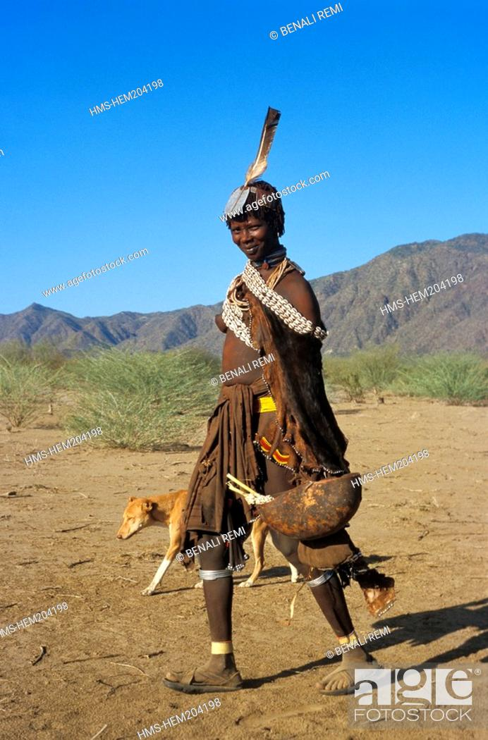 Stock Photo: Ethiopia, Lower Omo Valley, listed as World Heritage by UNESCO, woman from the Hamer Tribe dressed in an animal skin and bone necklace.