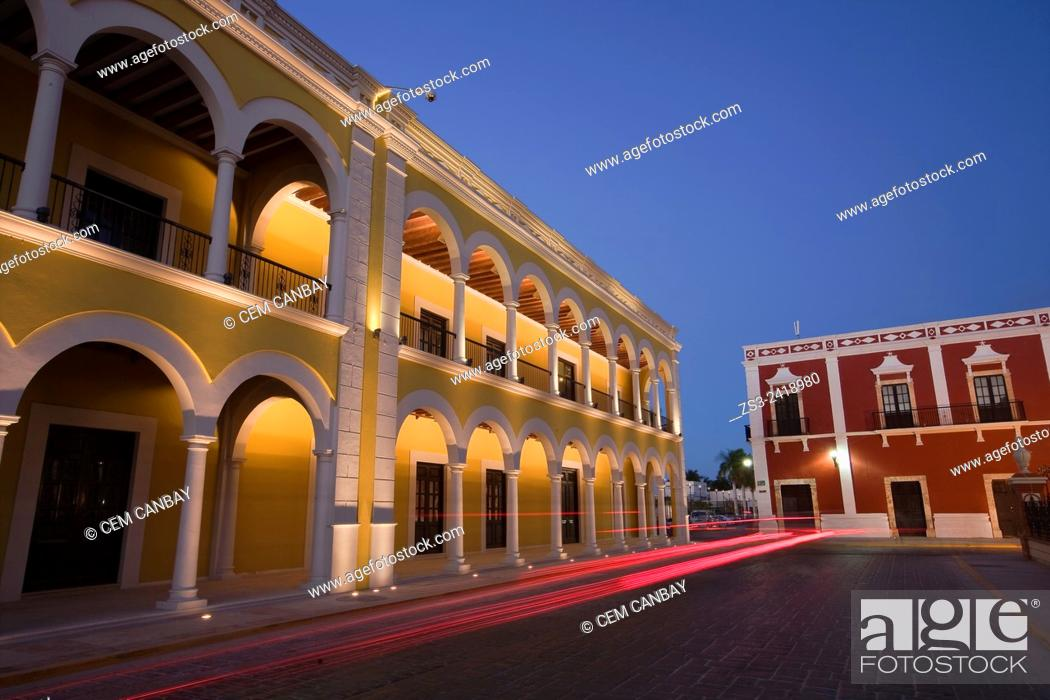Stock Photo: Yellow painted Nacional library building in Zocalo at the historical center listed as World Heritage Site by Unesco at night, Campeche City, Campeche State.