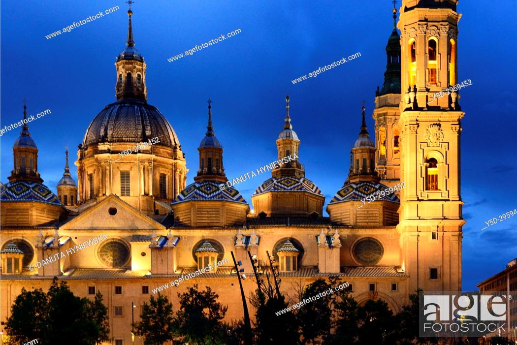 Stock Photo: Catedral-Basílica de Nuestra Señora del Pilar de Zaragoza, Cathedral-Basilica of Our Lady of the Pillar seen from the other bank of Ebro river at night.