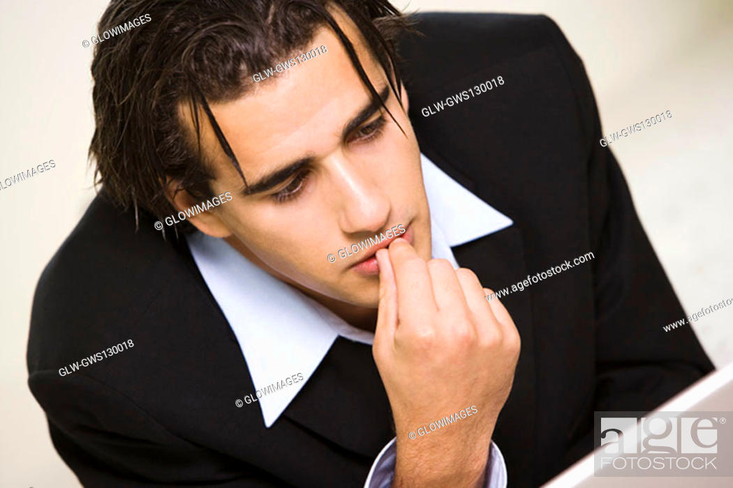 Stock Photo: Close-up of a businessman with his finger on his lips.