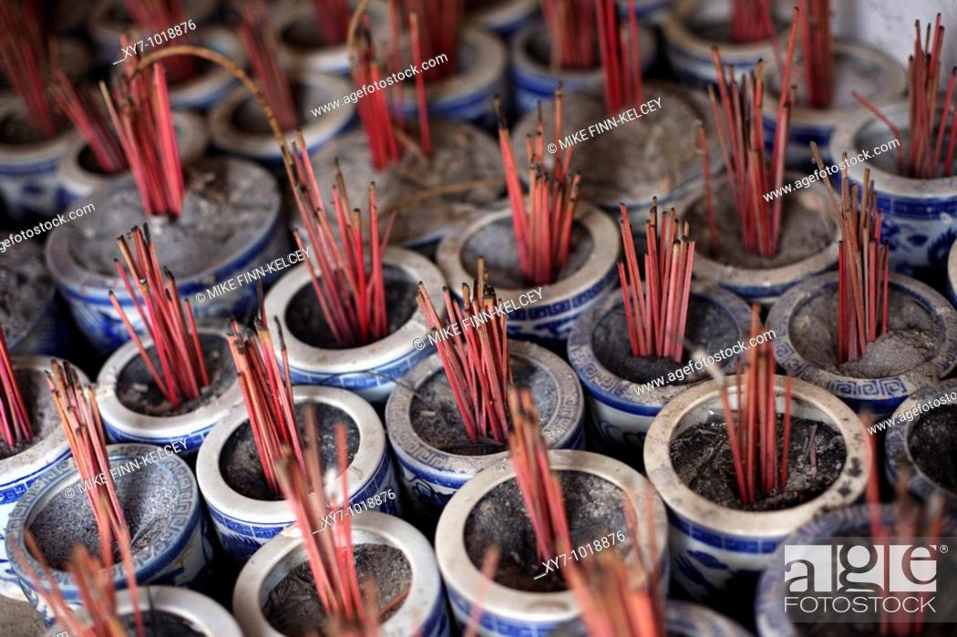 Stock Photo: Incense sticks burning at the Hoa Lu temple near Ninh Binh in northern Vietnam.
