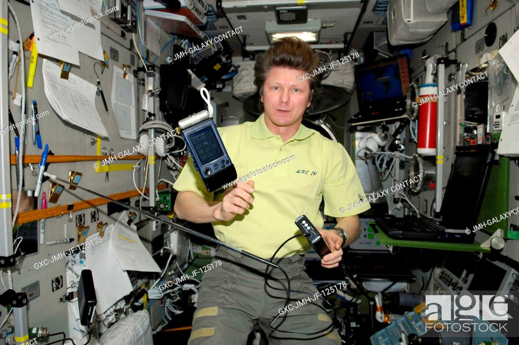 Stock Photo: Russian cosmonaut Gennady Padalka, Expedition 20 commander, uses the Russian BAREXPERT science payload to take various environmental measurements in the Zvezda.