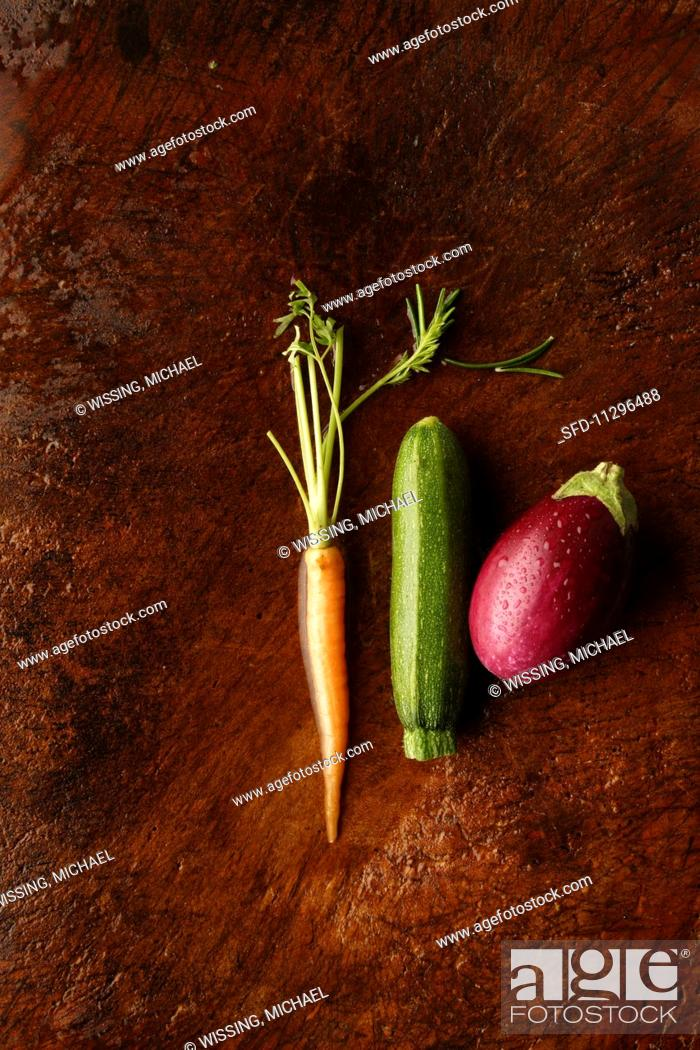 Stock Photo: A carrot, a courgette and an aubergine.