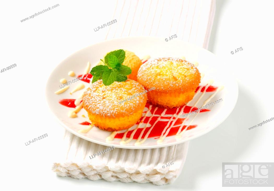 Stock Photo: Pudding filled cupcakes with ice cream.