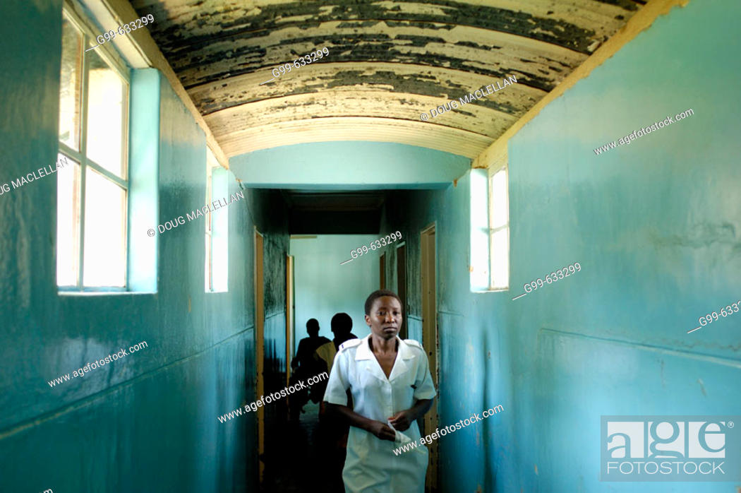 Stock Photo: A nurse walks the hallway from the Howard Hospital Emergency to the Male Ward. The eighty year old salvation Army operated facility sometimes shows its age.