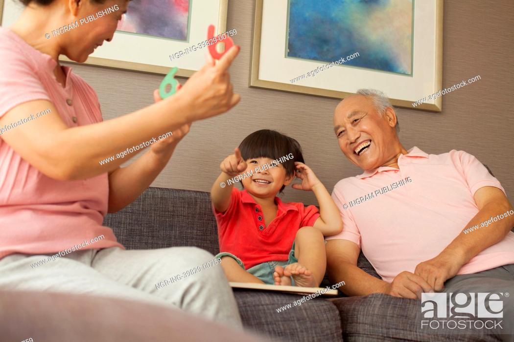 Stock Photo: grandson playing with grandparents.