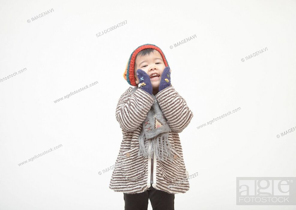 Stock Photo: A girl wearing in winter clothes.
