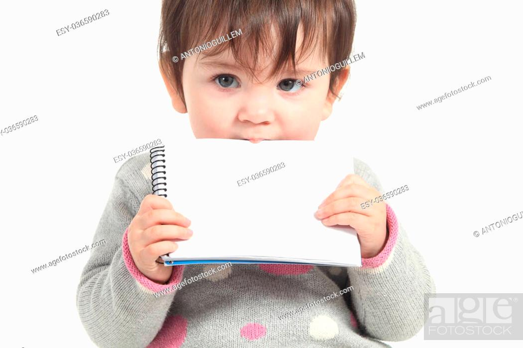 Stock Photo: Baby biting a blank notebook on a white isolated background.
