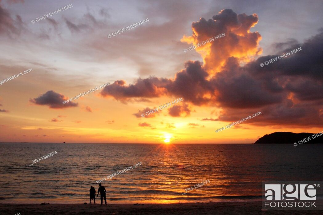 Stock Photo: A beach at sundown with Pantai Cenang of the island Langkawi in Malaysia in southeast Asia.