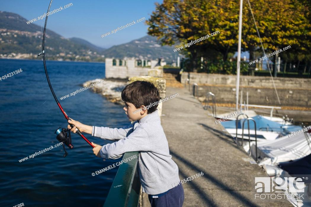 Stock Photo: child fishing at Lake Maggiore, Italy.