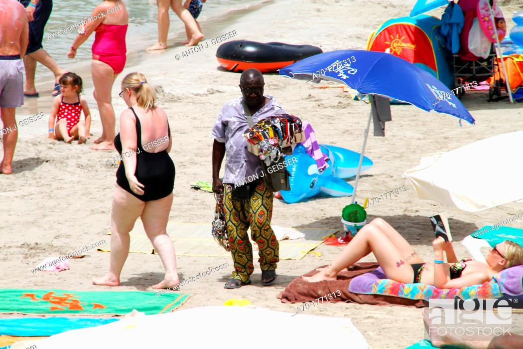 Stock Photo: Spain , balearic island , Ibiza , african beach trader.