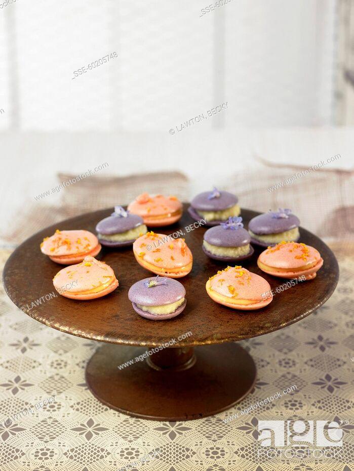 Stock Photo: Lavander and mandarin orange macaroons.