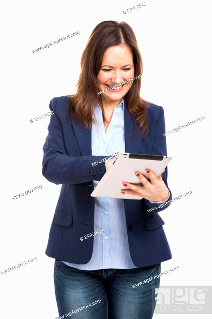 Stock Photo: Business woman holding and working with a tablet, isolated over a white background.