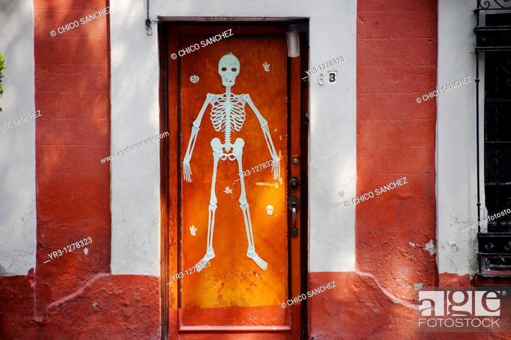 Stock Photo: A skeleton decorates a home's door in Coyoacan ahead of Day of the Dead celebrations, Mexico City.