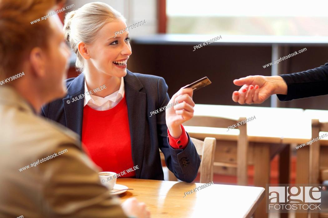 Stock Photo: Woman paying bill by credit card.