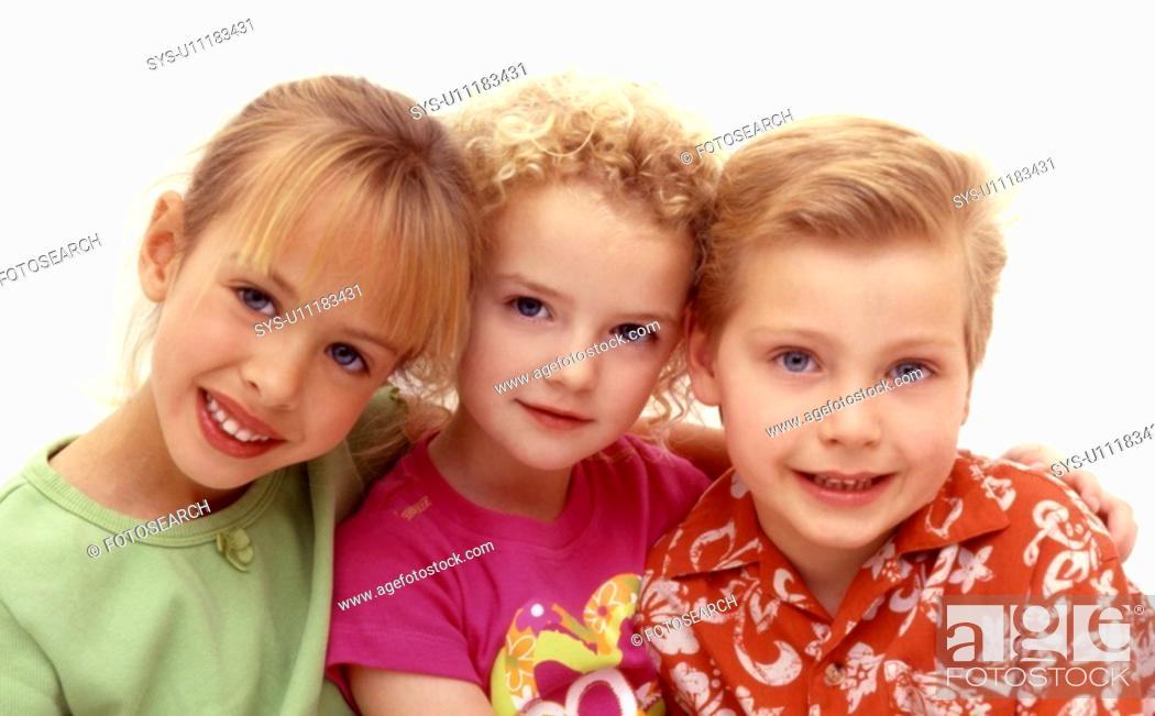 Stock Photo: Three young children sitting happily.