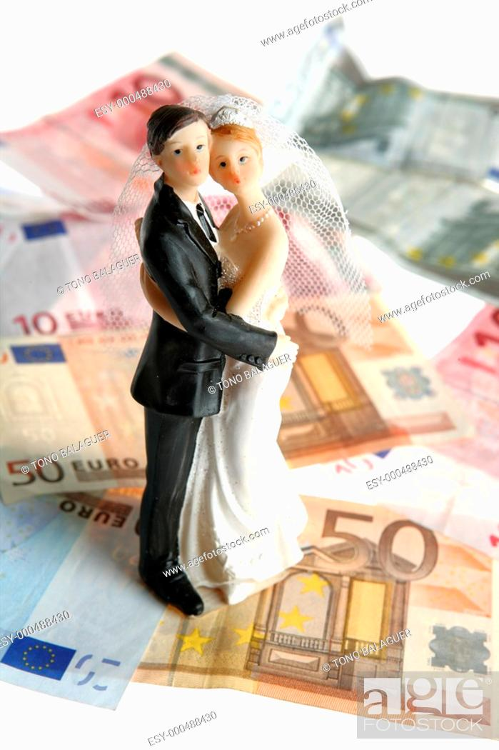 Photo de stock: Wedding couple figurine over euro notes background, love and money.