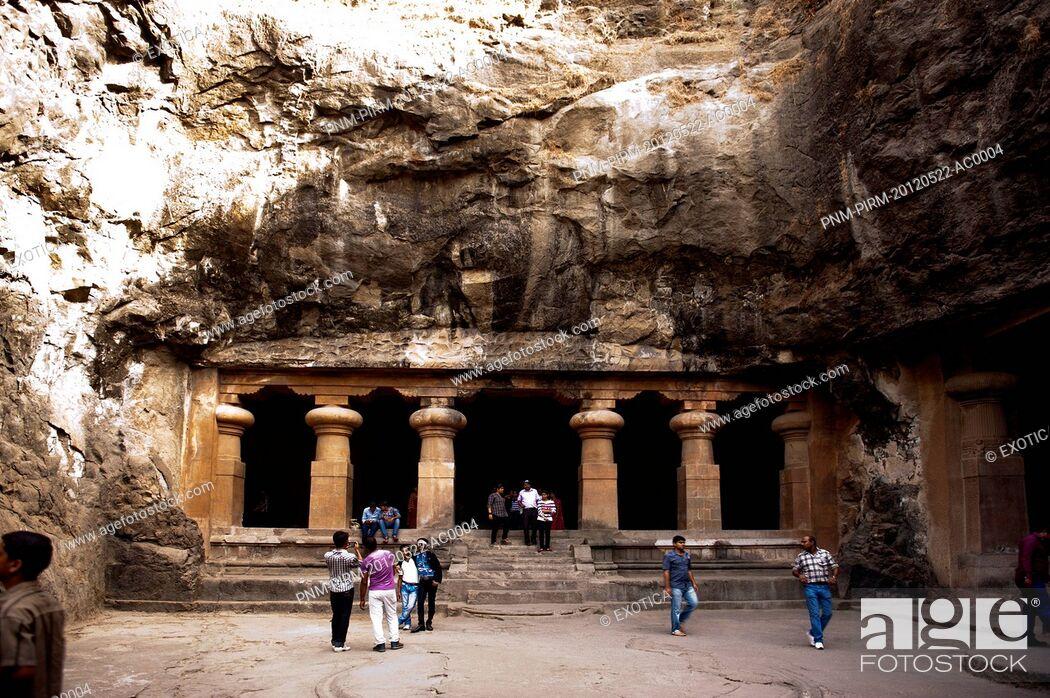 Stock Photo: Tourists at the entrance of a cave, Elephanta Caves, Elephanta Island, Mumbai, Maharashtra, India.