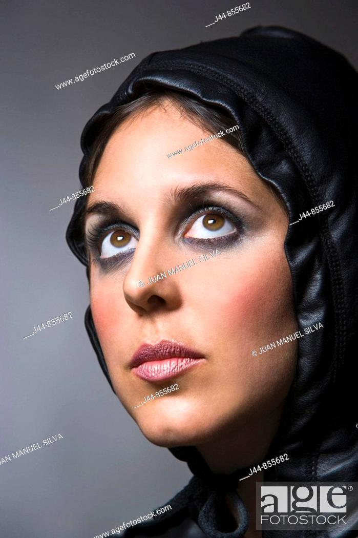 Stock Photo: Woman with leather hood, portrait.