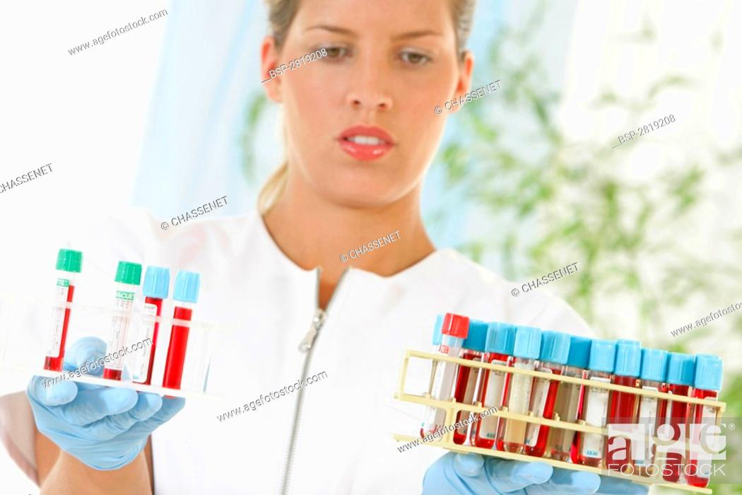 Stock Photo: BLOOD ANALYSIS Model.