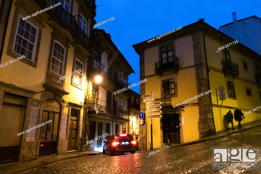 Stock Photo: Rainy night in a street in Porto, Portugal.