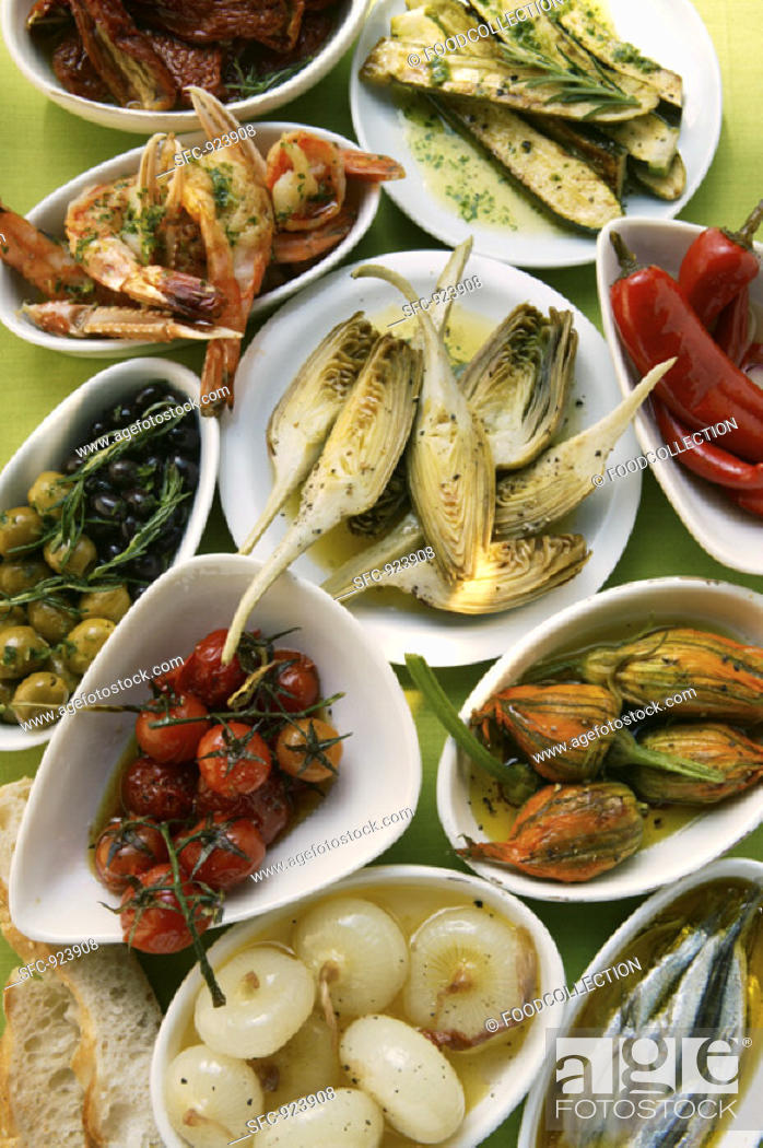 Stock Photo: Assorted antipasti: pickled vegetables, fish, scampi.