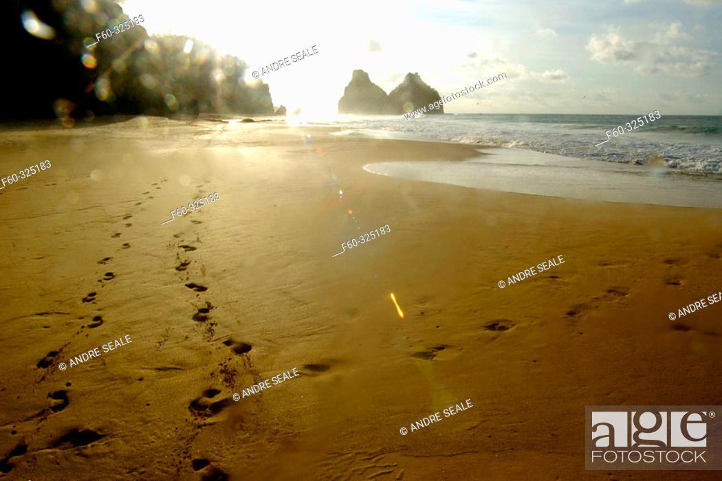 Stock Photo: Footprints in Cacimba do Padre beach and Dois Irmãos islands in background, Fernando de Noronha national marine sanctuary. Pernambuco state, Brazil.