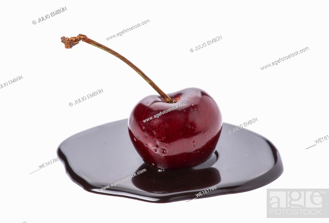 Photo de stock: cherry in chocolate puddle isolated on white.