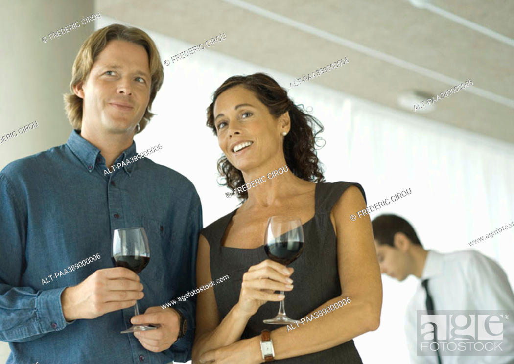 Stock Photo: Man and woman chatting and holding glasses of wine.