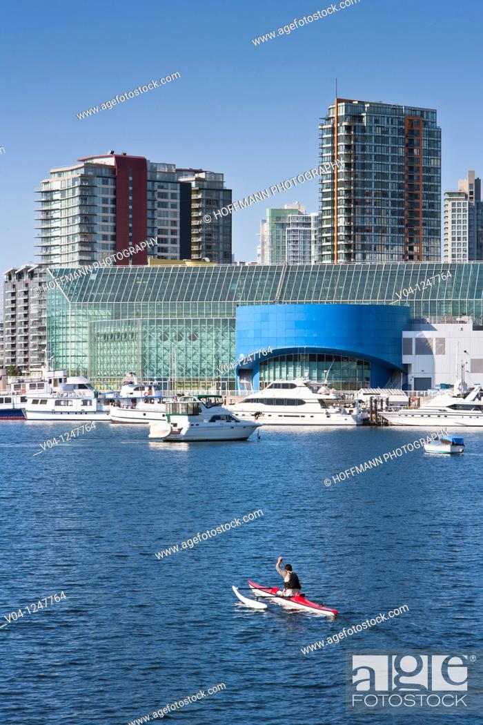 Stock Photo: A man in his canoe on False Creek, Vancouver, British Columbia, Canada.