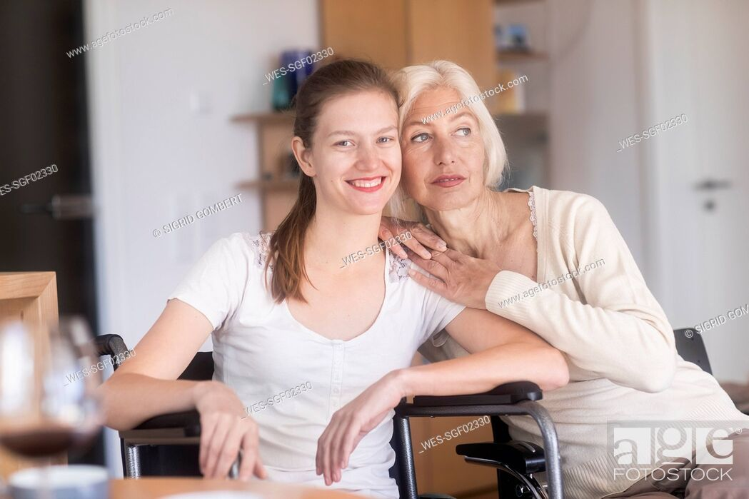 Stock Photo: Mother with daughter in a wheelchair.